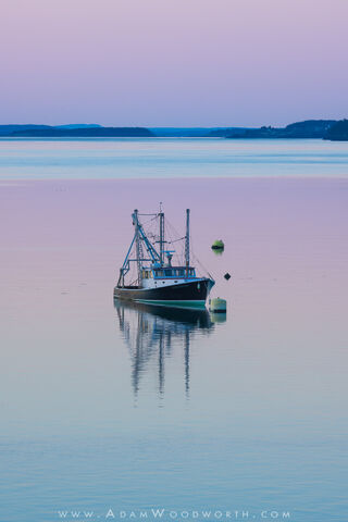 The Guardian Fishing Boat and Pastel Sunset