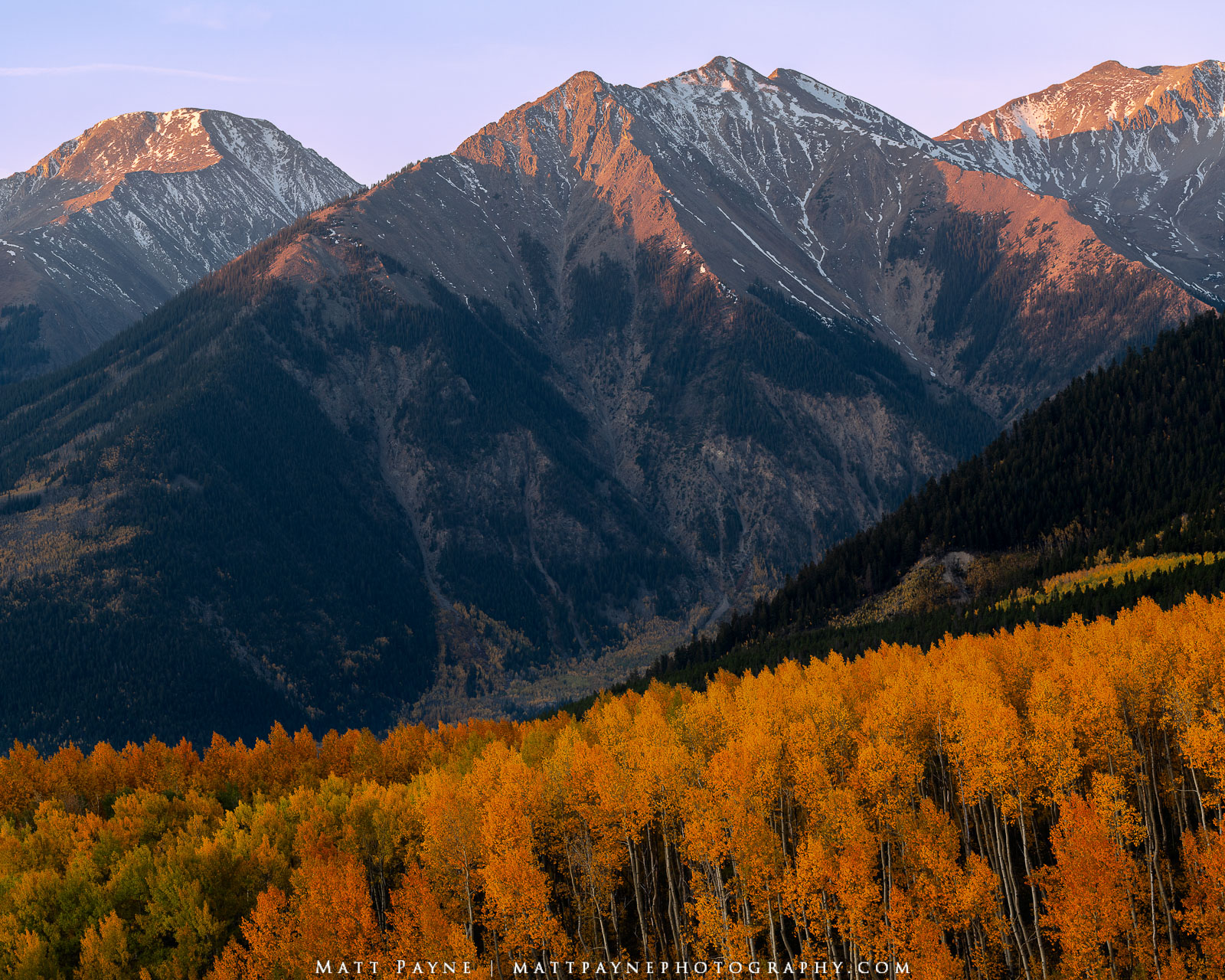 Mount Hope and Rinker Peak are illuminated by early sunrise light in autumn showcasing fall colors from the glorious transition...