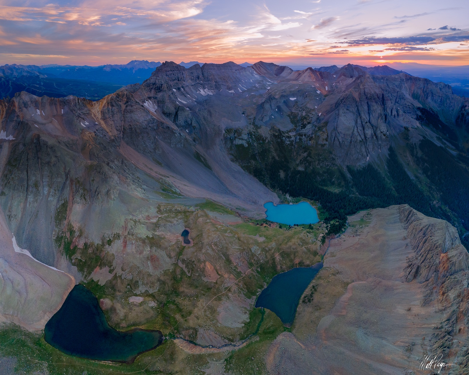 A high vantage view of some of my favorite mountains in the San Juan Mountains at sunset. These peaks tower above the popular...