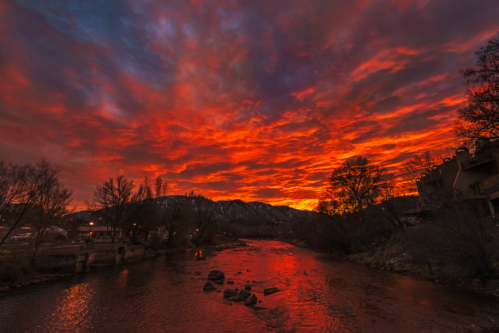 Wow - what an intense sunset from my backyard on the Animas River bridge looking towards Smelter Mountain here in Durango. I...