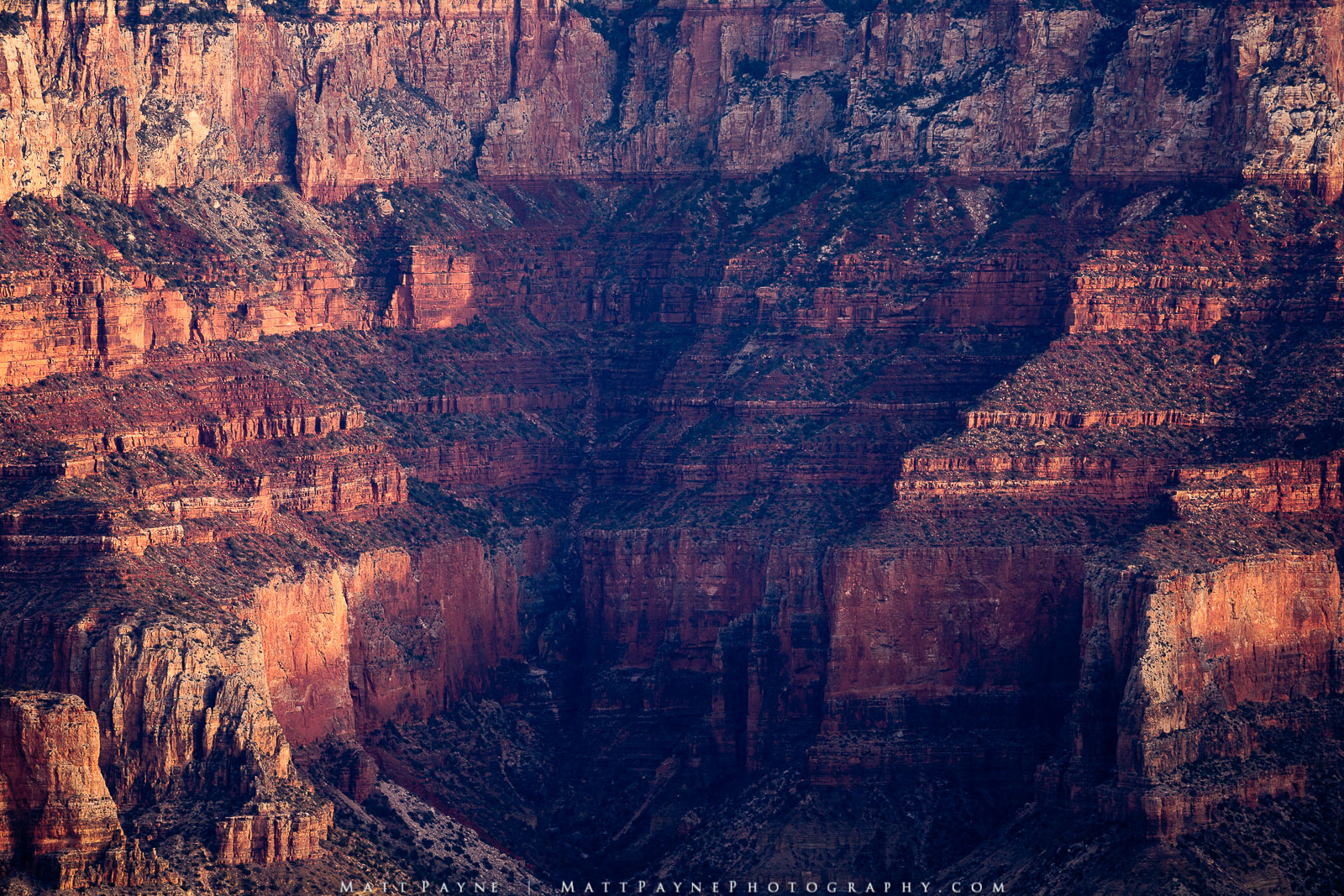 Layers upon layers of erosion revealed by sunrise light in Grand Canyon National Park. Photo © copyright by Matt Payne.