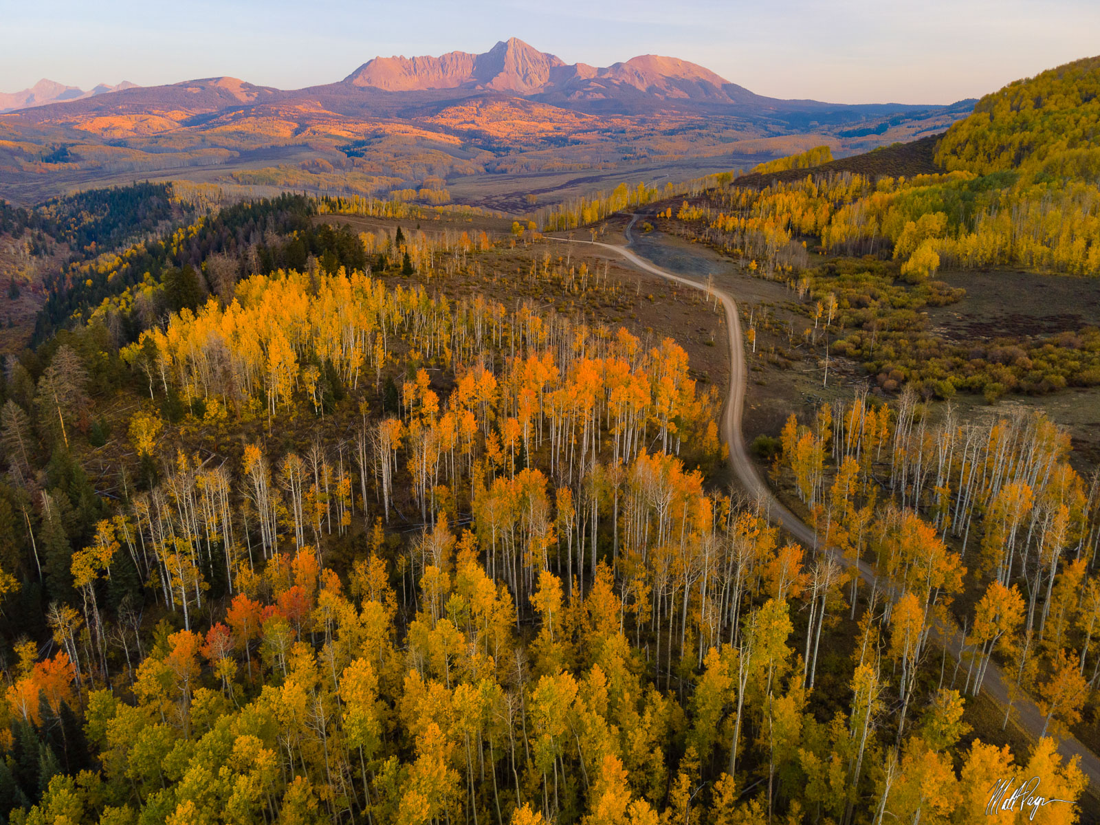 This country road in Colorado leads right through some amazing aspen tree stands filled with fall color. The road leads the eye...