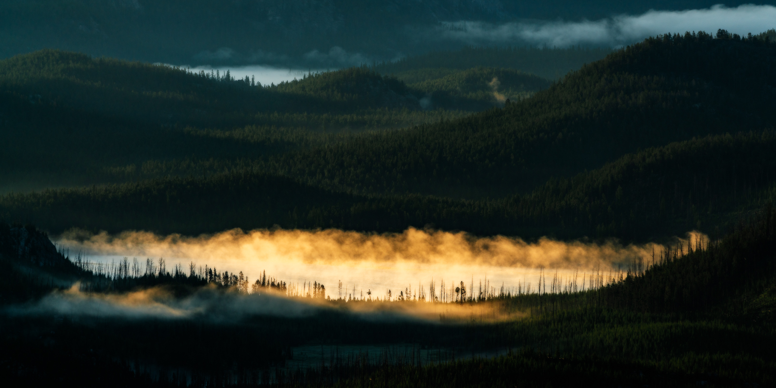 After a night of crazy thunderstorms near Cooke City, Montana, fog developed over a small lake at sunrise, making for a very...