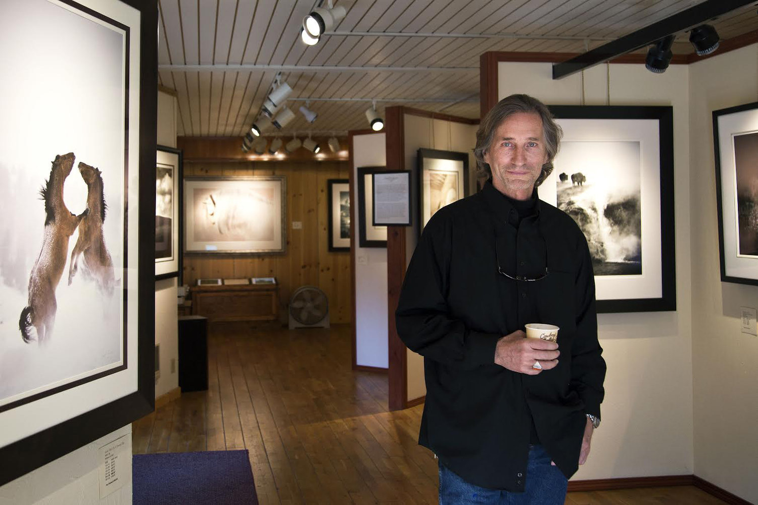 Photographer David Brookover stands among his work in The Brookover Gallery in Jackson. His traditional processes for reproducing...