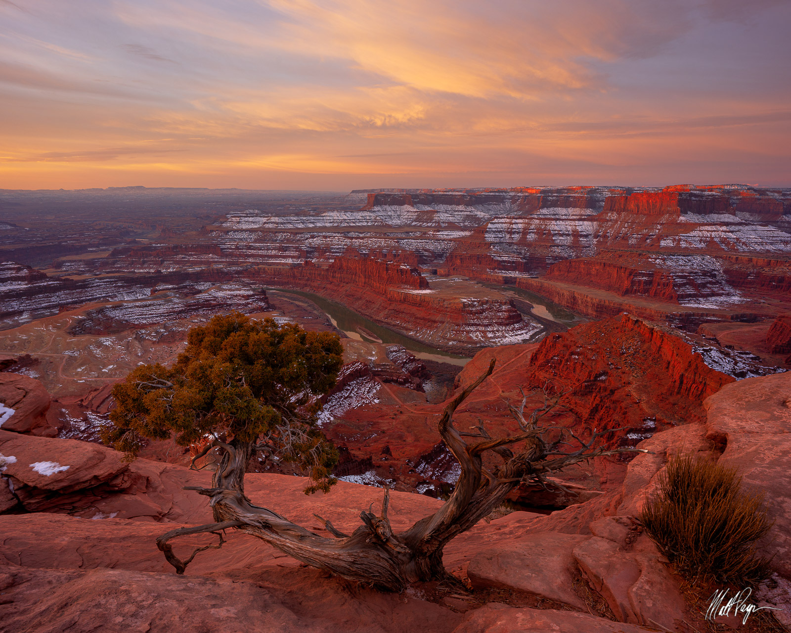 Dead Horse Point State Park at sunrise in winter is a peaceful desert destination featuring the Colorado River and a lot of amazing...