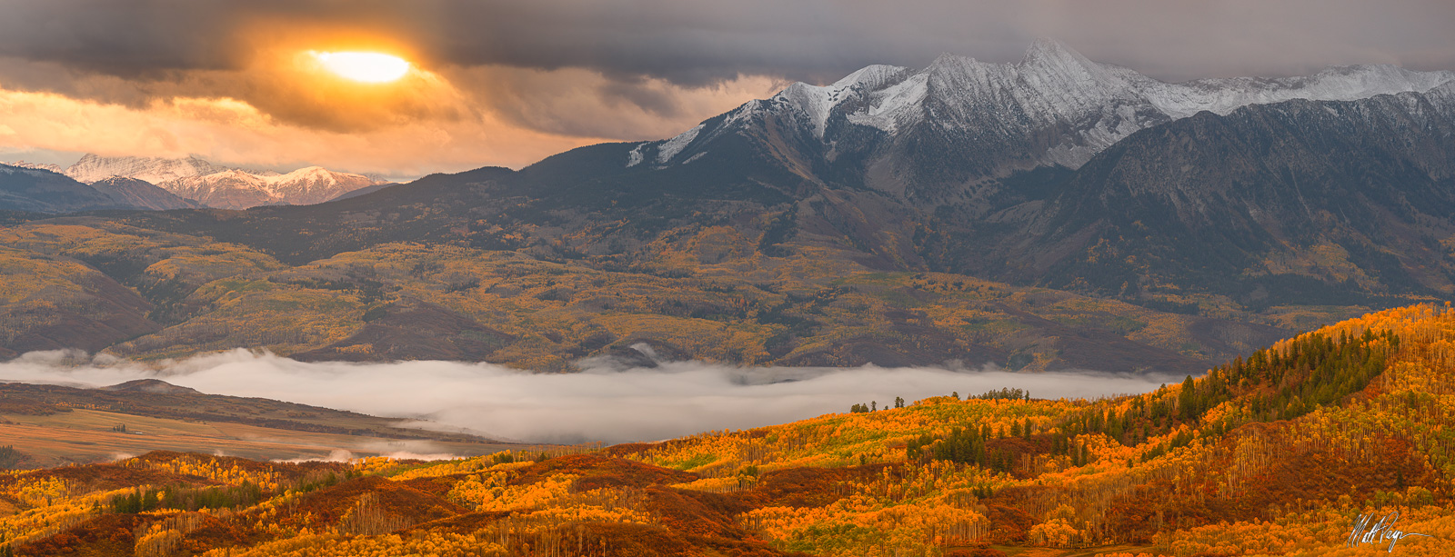 The first light of day at sunrise in autumn as seen in the West Elk Mountains of Colorado near the town of Paonia. This panorama...