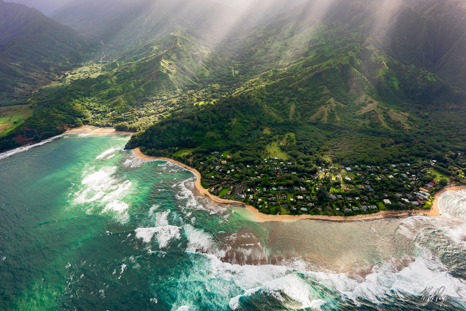 Diffused sun rays cast amazing light onto the town of Hanalei in Kauai as seen from above in a helicopter.Photo © copyright...