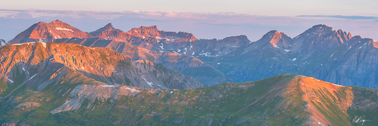 This high mountain sunrise panorama from the San Juan Mountains of Colorado features some of my favorite 13ers (mountains higher...