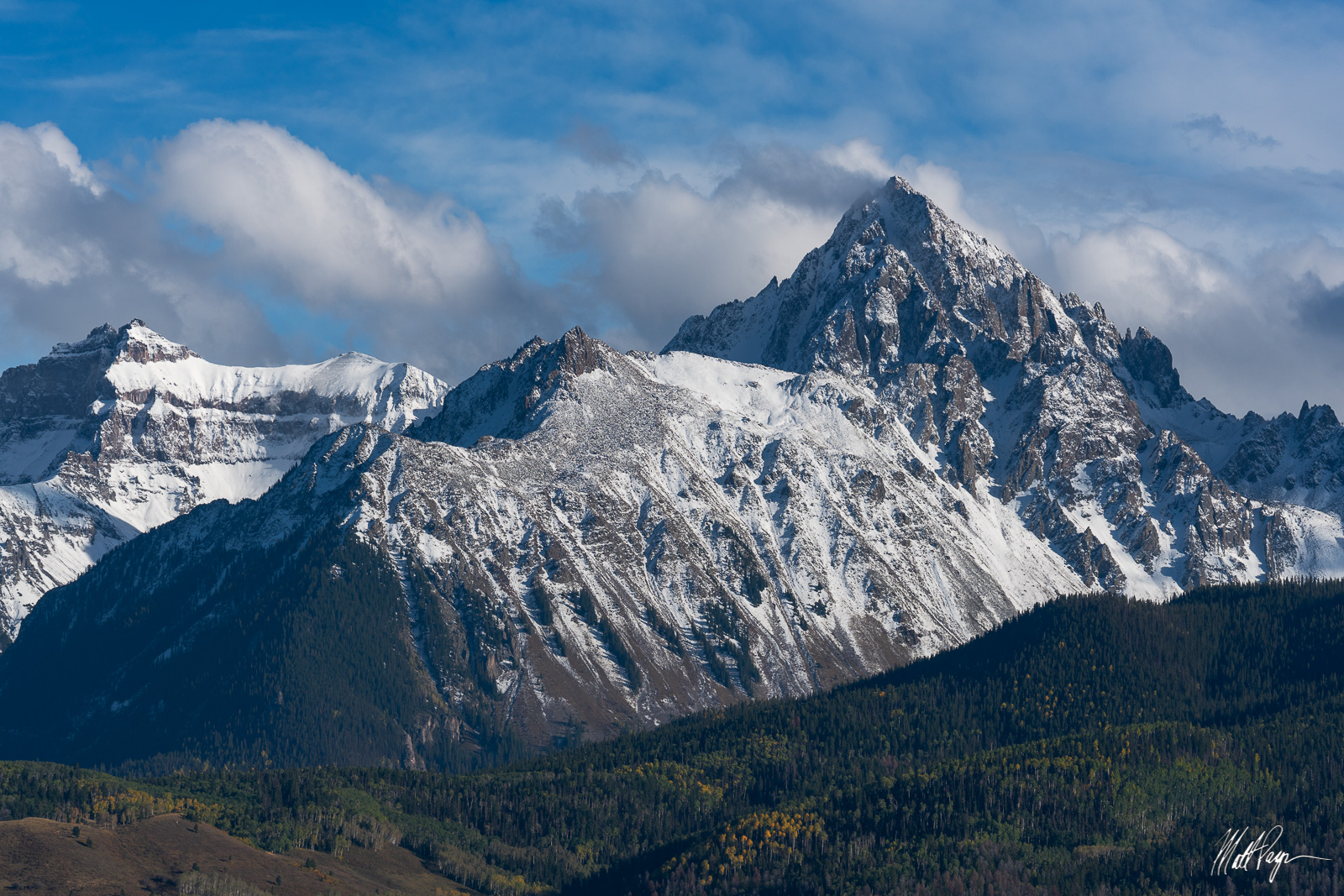 Colorado 14er Mount Sneffels and other mountains bask in afternoon light near Dallas Divide / Ridgway / Telluride after...