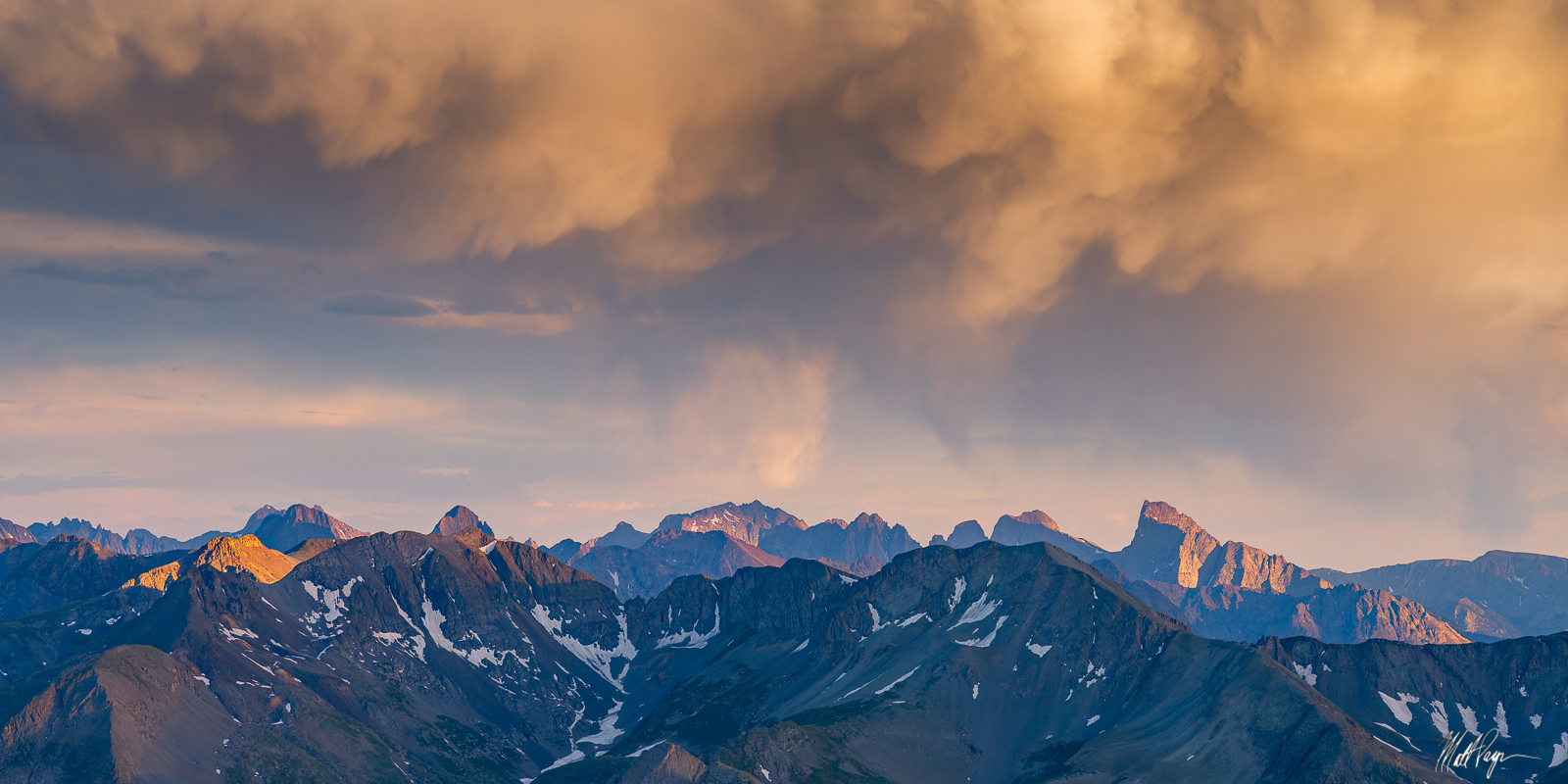 This panorama of the San Juan Mountains near Silverton, Colorado features some impressive cloud formations at sunset above some...