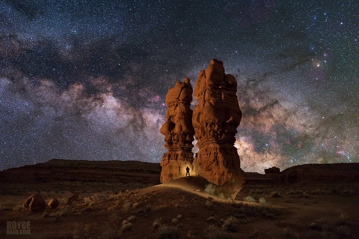 Sid & Charlie hoodoos, San Rafael Swell, Utah with selfie and light painting. Cloudy night sky replaced with a Milky Way taken...